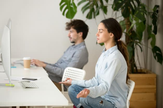 3 Simple Yoga Poses You Can Do at Work