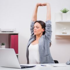 Stretches To Do While Sitting at Your Desk (And Staying Seated!)